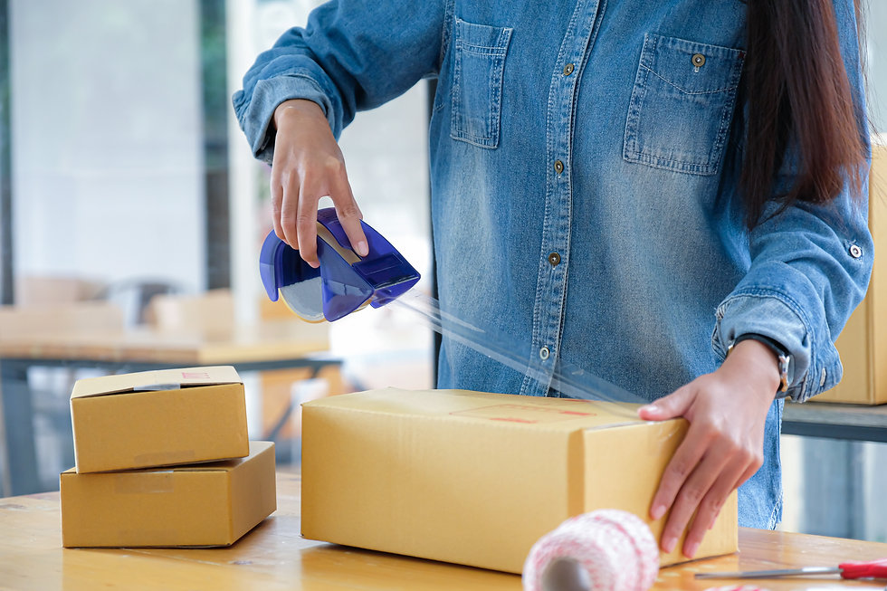 teenage-girls-are-packing-products-in-bo