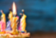 closeup of some unlit candles and just o