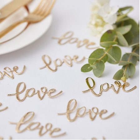 Gold love table confetti.png