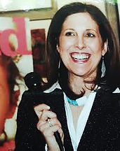 Writer, Editor, Brand Consultant Miriam Arond speaking at an event