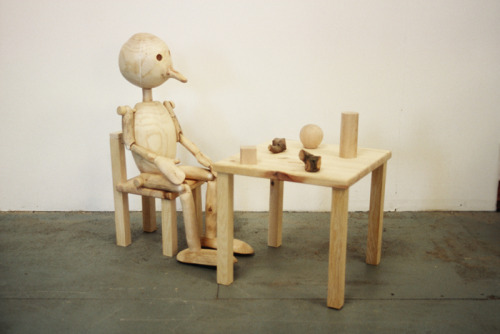 Extrospection (figure with wooden objects)