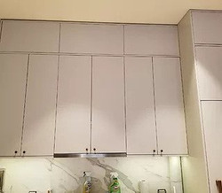 Euro-style flat panel with touch latch