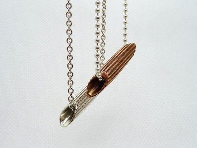 silver & bronze pasta penne pendant on silver necklace