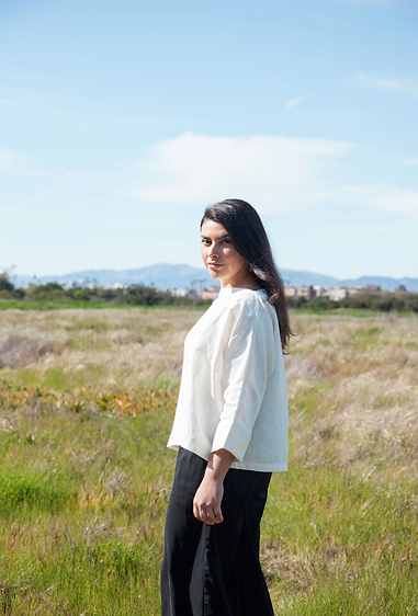 Andrea Penagos in a field of grass at the Ballona Wetlands in Los Angeles, California.