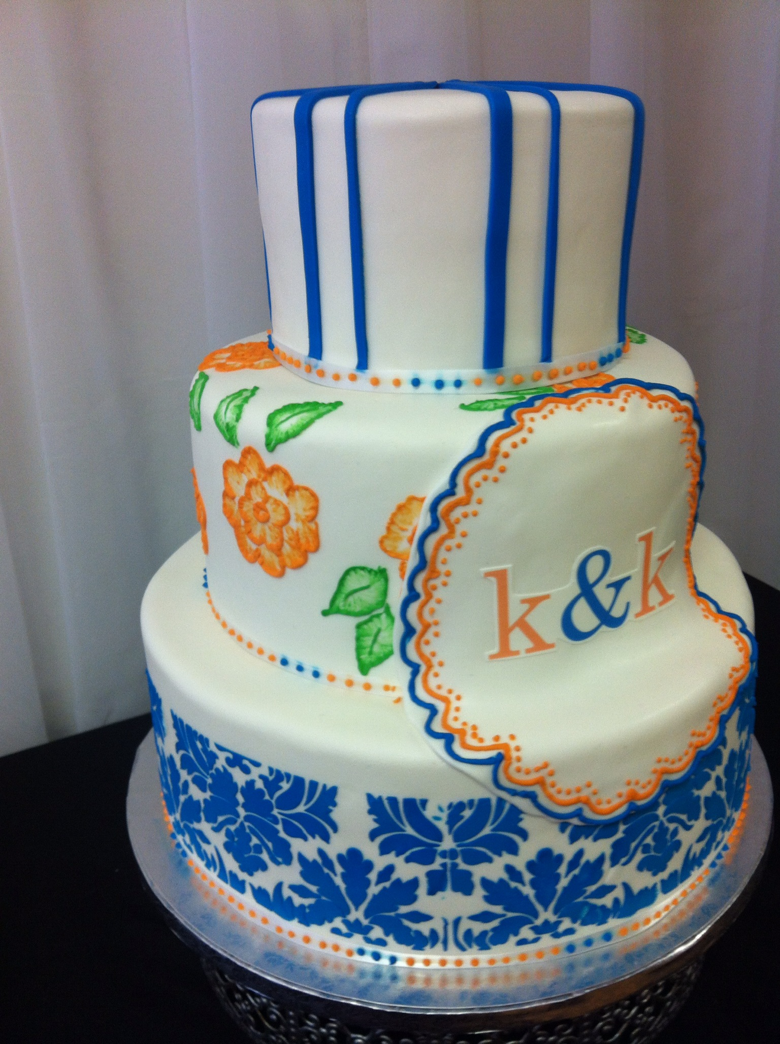Orange and blue wedding cake