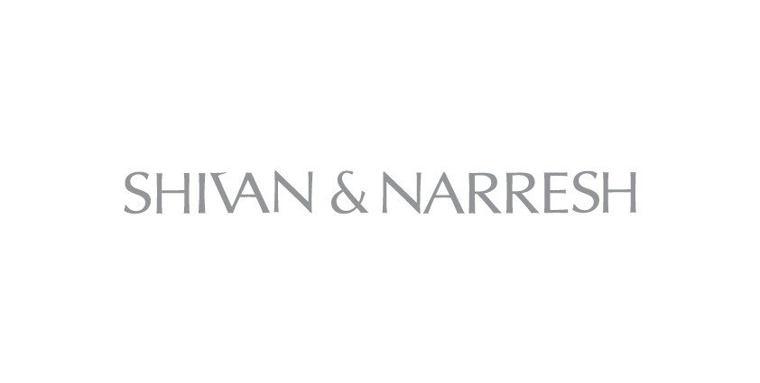 The 'R' from Shrivan was removed and the ampersand was added to the logotype to indicate that these are the names of two different people since internationally people would confuse it to be the name of a single person. Kerning of the overall logotype was also improved.