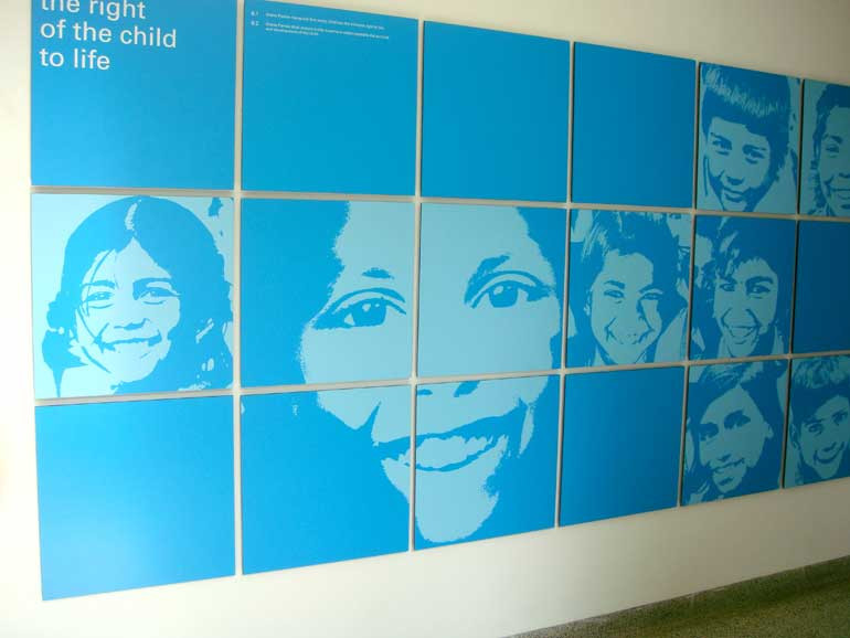 Ground floor lobby: These squares could be replaced or their position interchanged as they were designed keeping modularity in mind. The wall has a vinyl with the Rights of the Child printed on it in 2% black and related keywords in larger, more abstract looking Indian regional text to bring the India connect.