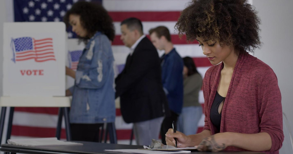 Voters using a United States Pol booth