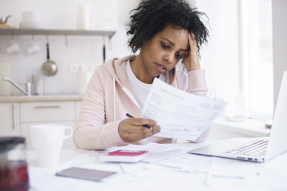 Young african american female having serious financial problems, feeling stressed