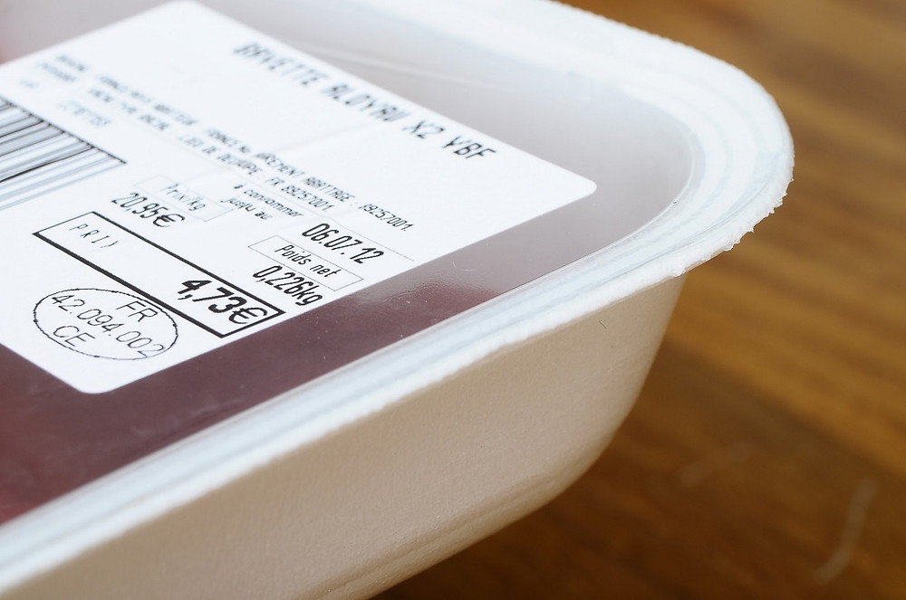 Food label on plastic film for meat with peremption date
