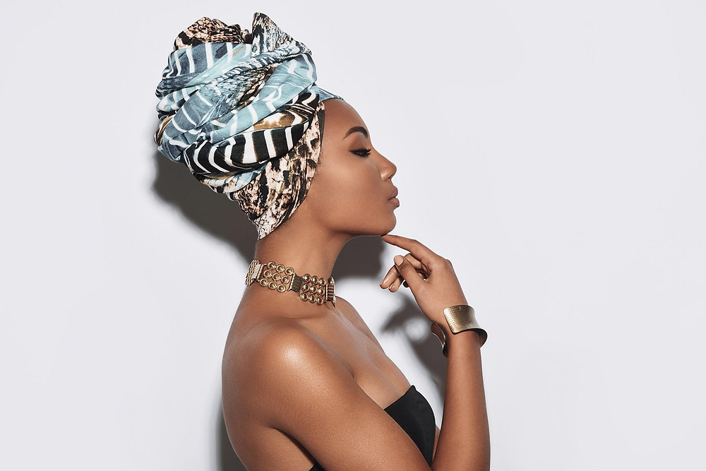 Side view of attractive young African woman in turban