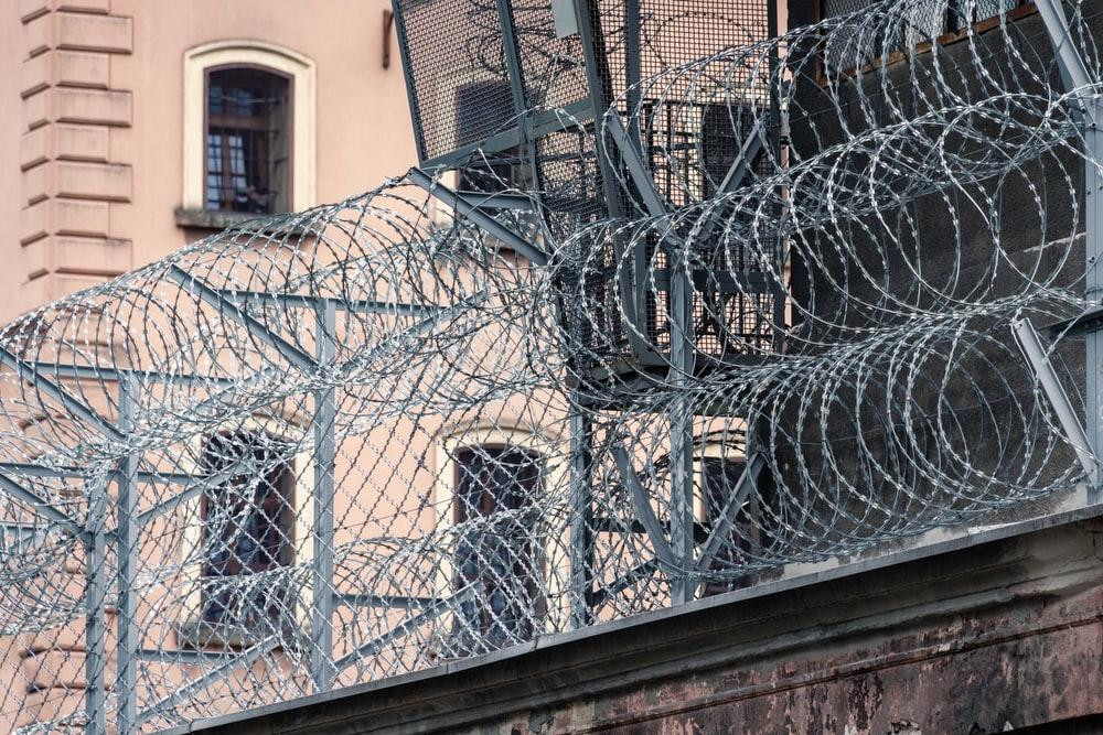 gray barbwire on fence near building