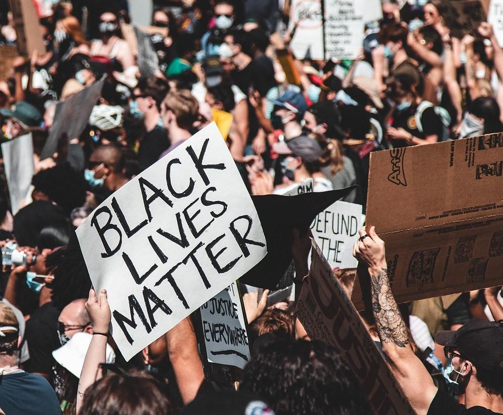 protesters holding Black Lives Matter sign