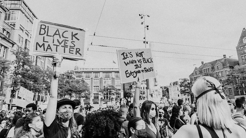 people holding signage for black lives matter