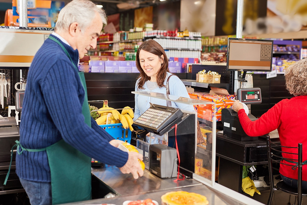Cashier Scanning Products in Grocery Store