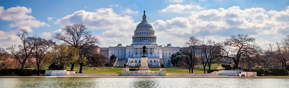 A cloudy sky in behind the US Capitol building in Washington DC.