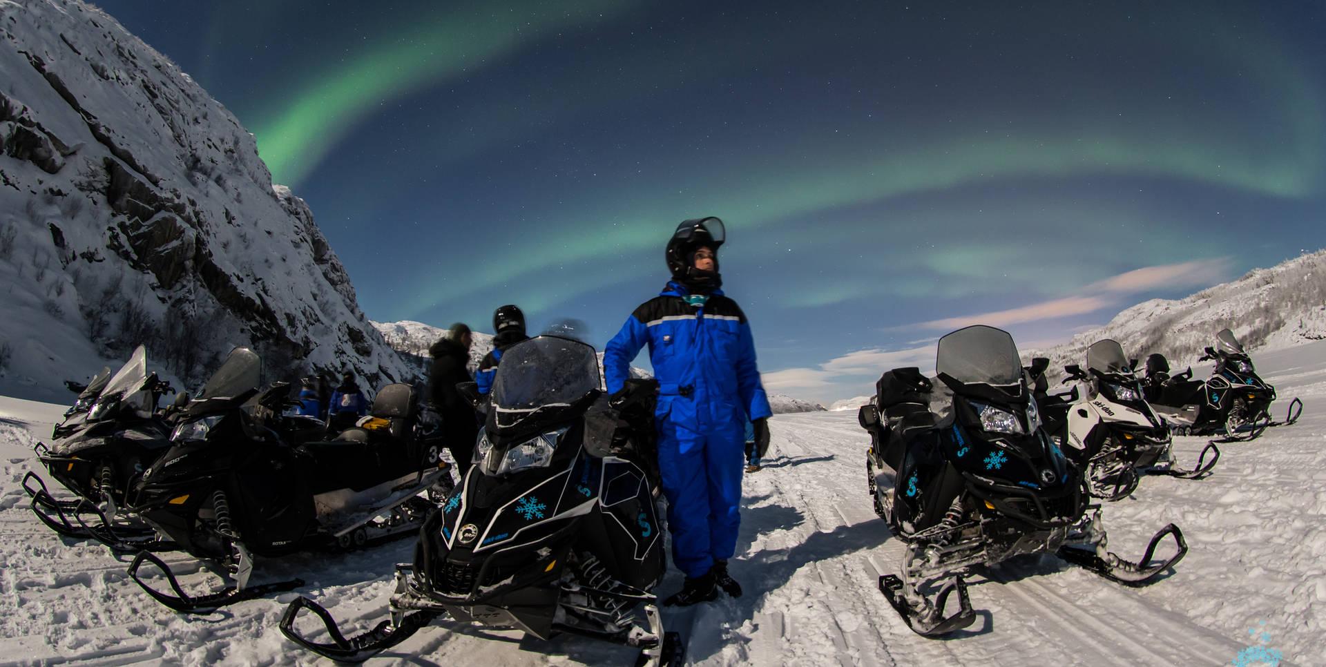 Snowmobile northern lights Kirkenes