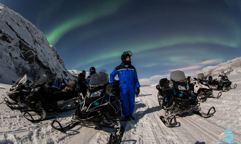 Snowmobile northern lights Kirkenes
