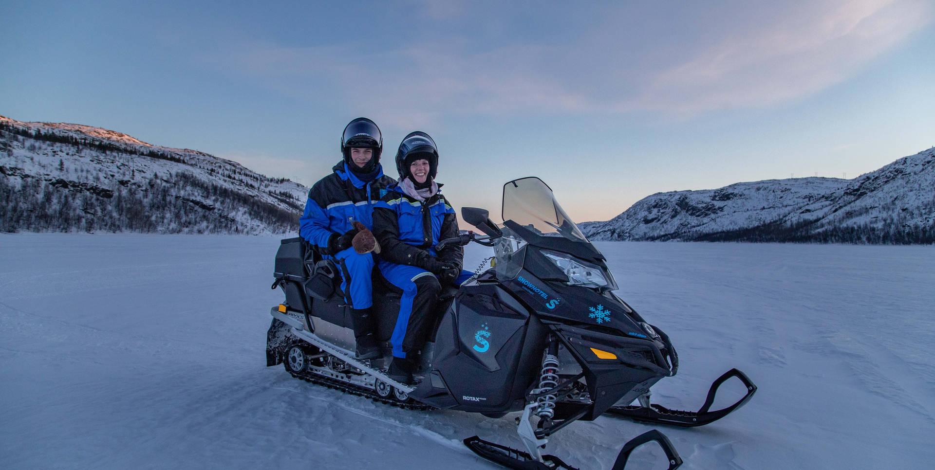 Romantic snowmobile tour
