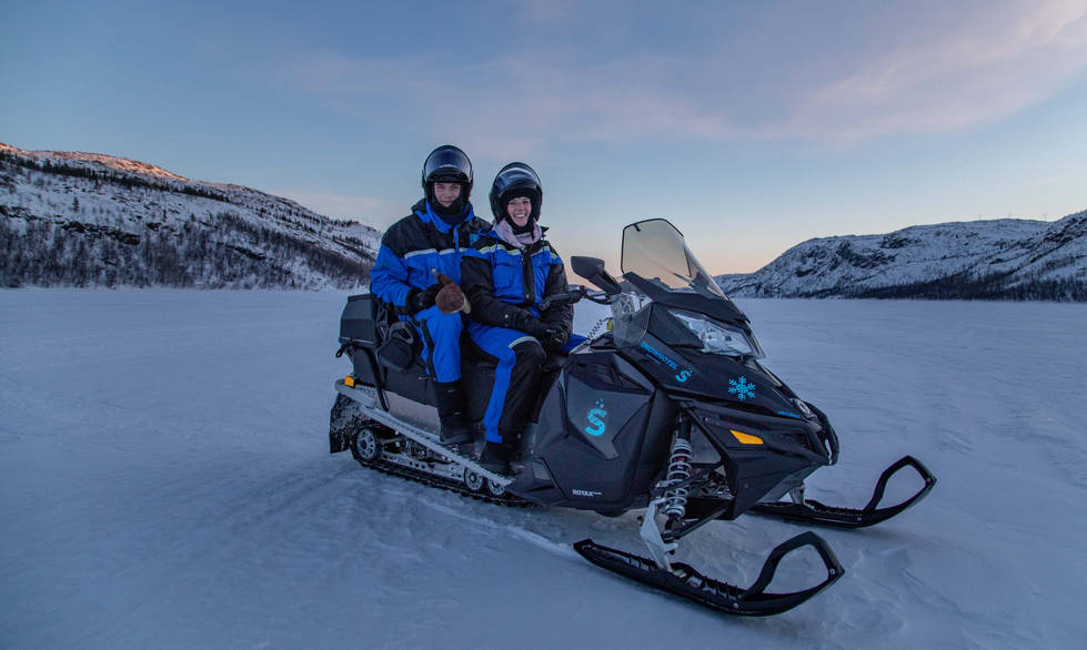 Romantic snowmobile tour