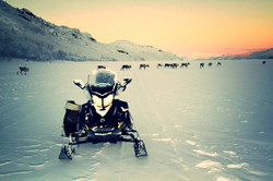 Snowmobile on fjord