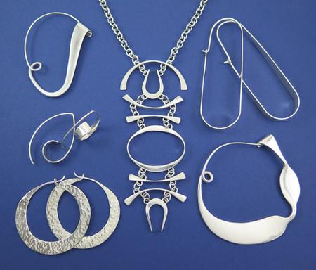 Forged pendant, earrings and fibulas