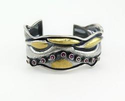 Phoebe's Golden Spots cuff bracelet