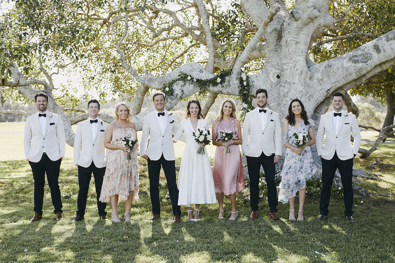 The gorgeous bridal party under the picturesque fig tree