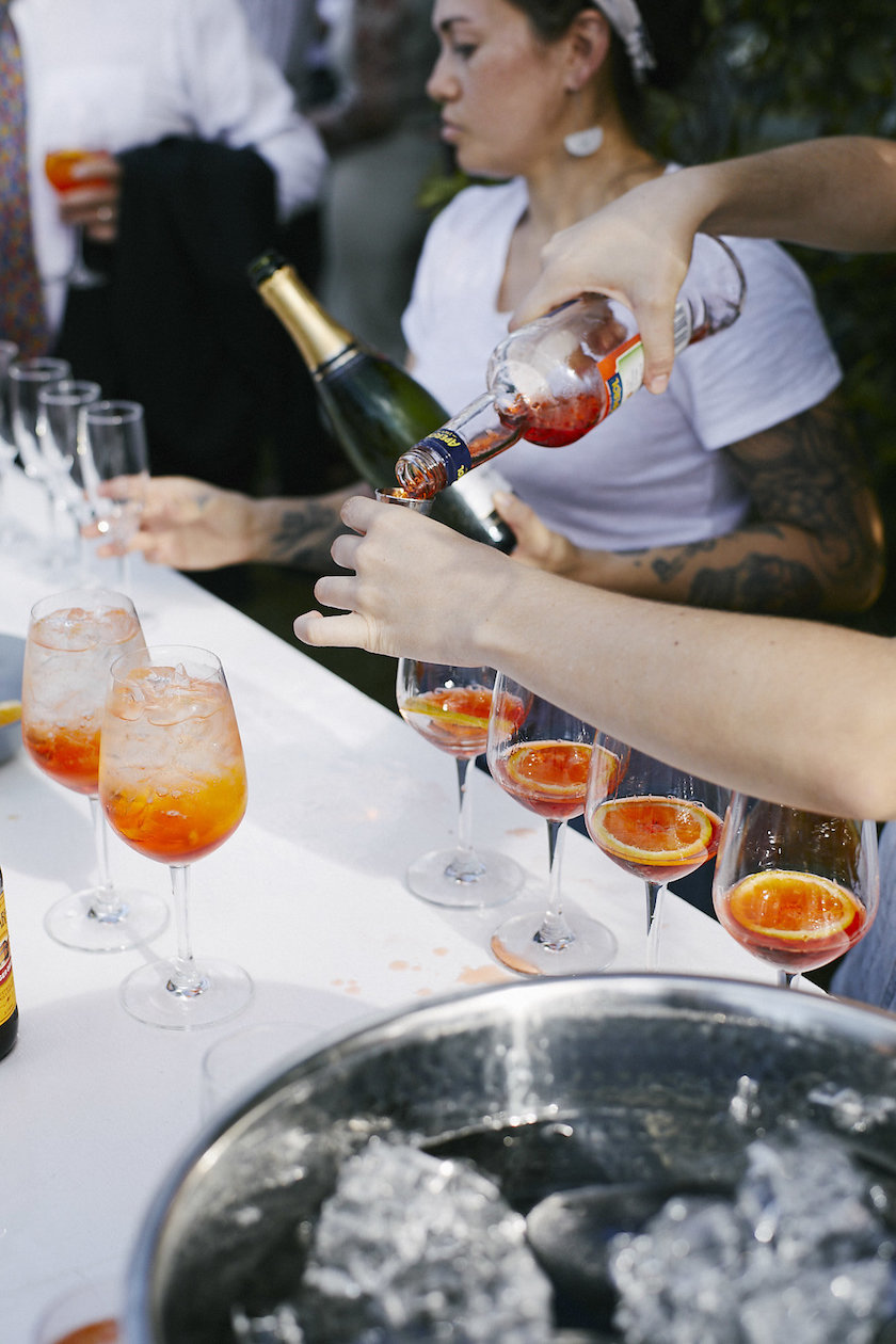Aperol Spritz all round. Being served up by the Leche workers