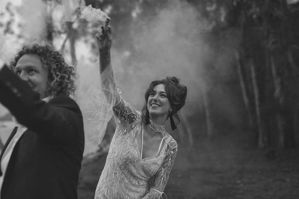 Bride and groom with smoke flares
