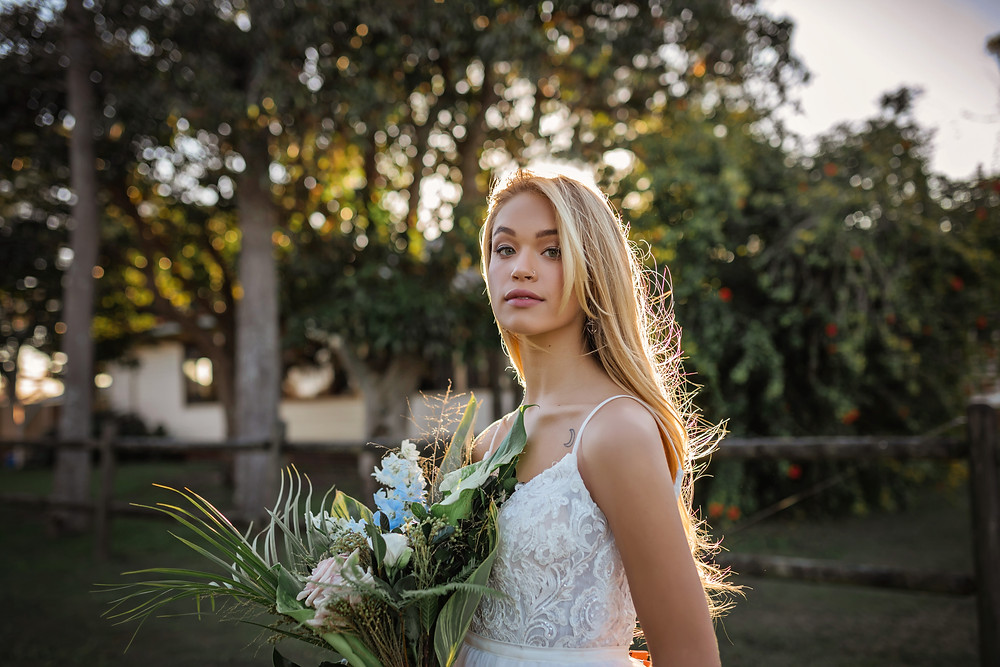 Yamba bride standing with flowers