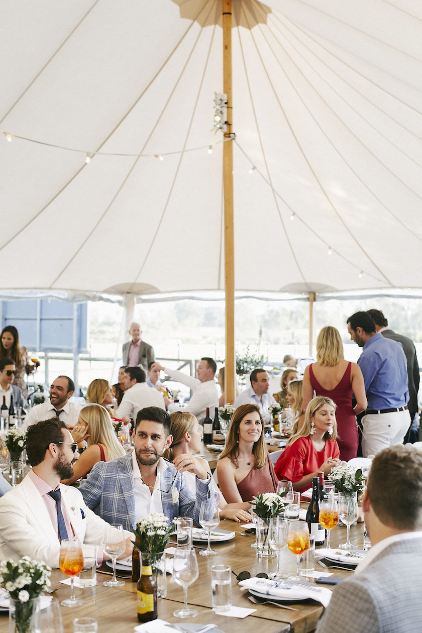Guests settle in under the large Sperry tent for their sit down meal