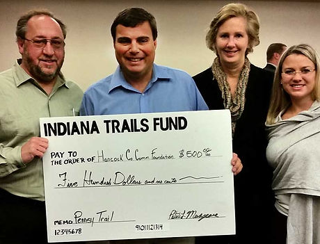 Members of Howard County Community Foundation holding a giant check from Indiana Trails Fund