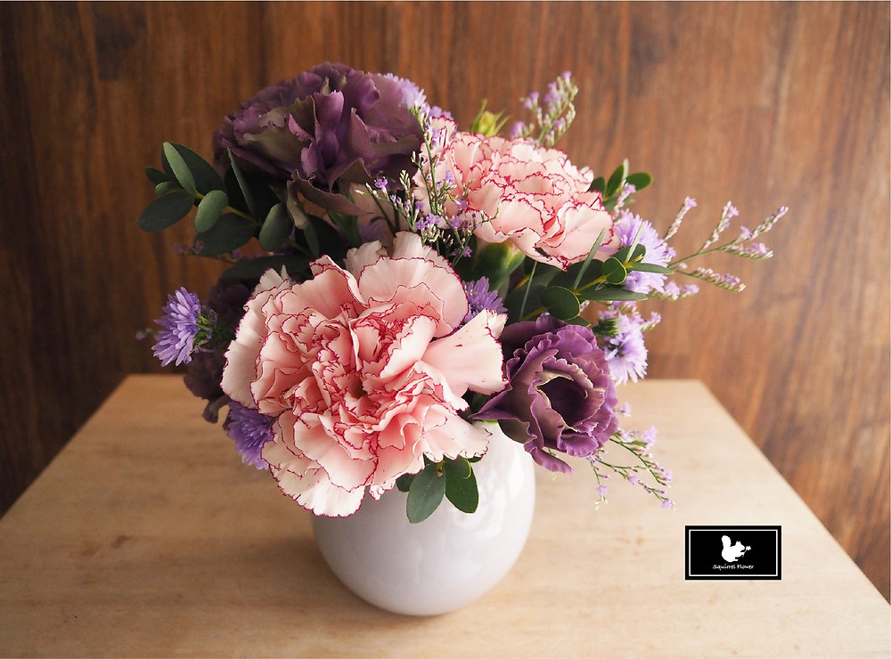 手提小盆花