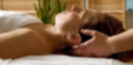 A woman receives reiki energy treatment