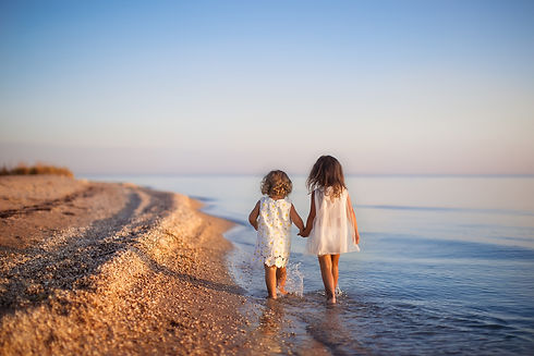 two little girls are on the beach.jpg