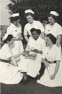 Mabel Dinah seated and fellow nurses