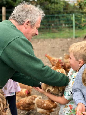 David with child and chicken.jpg