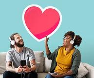 interracial-couple-listening-music-holdi