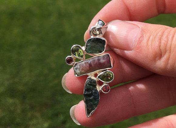 Rough tourmaline, peridot and garnet pendant