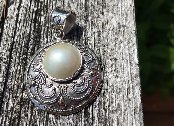 White pearl with gold accents pendant