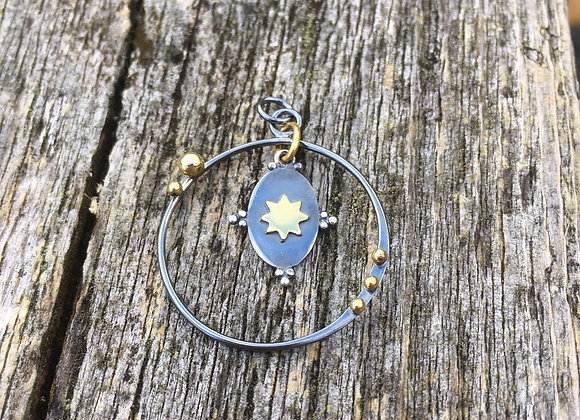 Floating bronze star and oxidized silver