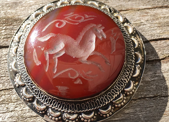 Vintage hand carved carnelian horse pendant