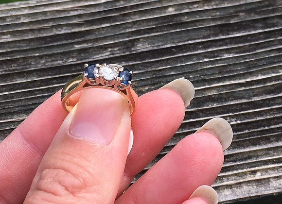 14 carat gold sapphire and diamond ring appraised at 1800.00