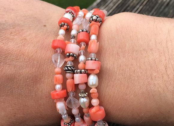 Multi strand coral, rose quartz and pearls bracelet