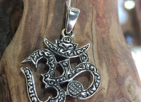 Carved ohm pendant