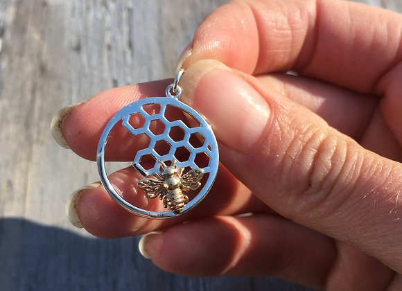 Round honeycomb with bronze bee pendant