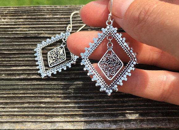 Detailed dangle silver earrings
