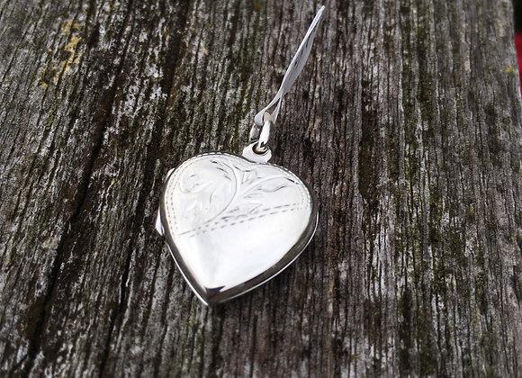 Half carved small heart locket