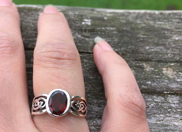 Oval garnet Celtic ring